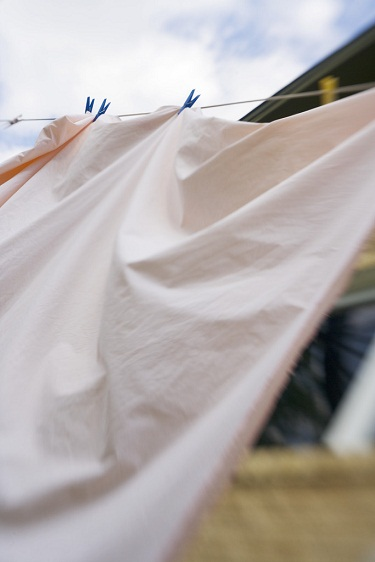...to see the possibilities of cleaning those sheets, (blinders), and let them hang off of the line, the wind blowing it  to and fro. (Image: Office.com)